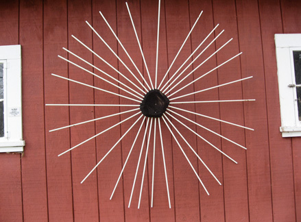 Eclipse, fiberglass wands and burned wood, 6' diameter x8'